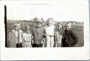 rppc Six Students standing by field from Painted Post New York 1912