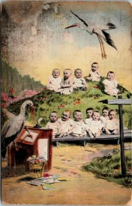 RARE - BABIES ON HILL - SCHOOL STORKS ANTIQUE POSTCARD - VINTAGE POSTED