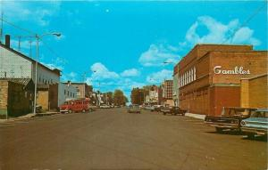 Park Falls Wisconsin~Gambles on This End~Red Van w/Rowboat on Top~1960s Postcard