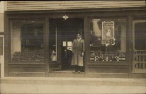Storefront Store Man in Doorway THEATRE POSTER FOR LAMBERT HALL in WINDOW rppc