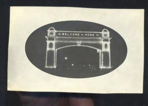 RPPC WELCOME ARCH NIGHT WWI ERA DOWNTOWN STREET SCENE REAL PHOTO POSTCARD
