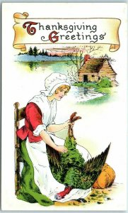 Vintage 1910s THANKSGIVING Postcard Pilgrim Woman Plucking Dead Turkey - UNUSED