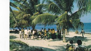 ANTIGUA , 50-60s ; Dancing to steel drums on beach