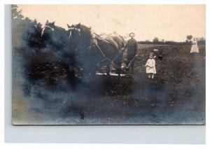 Farmer with Plow Horses, little girl holding reins RPC