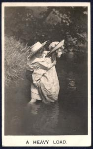 'A Heavy Load' Girl Carrying Boy Over Water used c1908