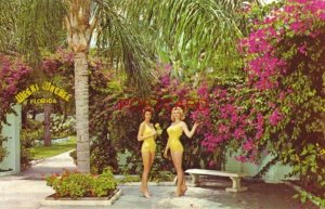 two MERMAIDS of WEEKI WACHEE pose on the patio, north of CLEARWATER, FLORIDA