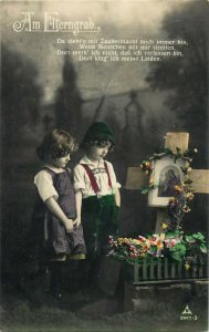 Children couple praying at the parents grave Am Elterngrab early tinted postcard