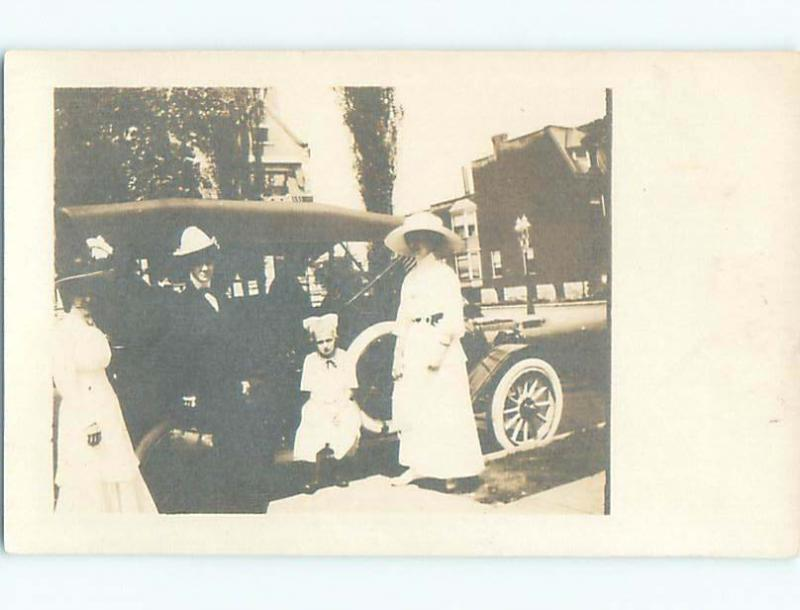 Pre-1918 rppc GIRL WITH BOW IN HAIR BY THE CAR o1776