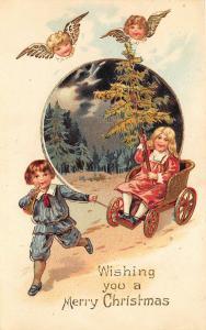 Wishing You Merry Christmas Boy Pulling Girl Cart Angels Embossed Postcard