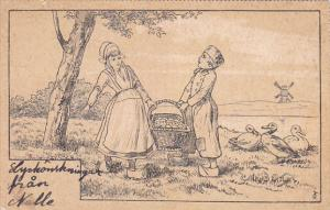 Dutch boy and girl carrying basket of apples, Windmill, 00-10s