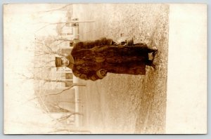 RPPC~Mr Harry Carbon Is All Bundled Up in a Fur Coat~Carrles Leather Bag~c1910