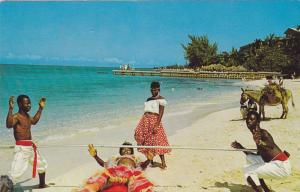 Doing the Limbo on the beach, Donkey in background, Jamaica, West Indies, PU