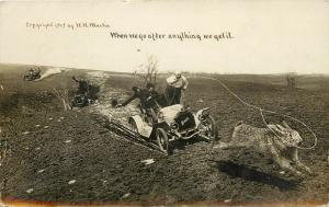 1909 WH Martin Exaggeration RPPC Men Lasso Huge Rabbit from Running Cars Buick