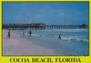 Surfing and swimming by Cocoa Beach Pier, Florida, 50-70s