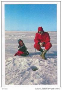 Closeup of Ice Fishing on Lake, USA 1950-60s