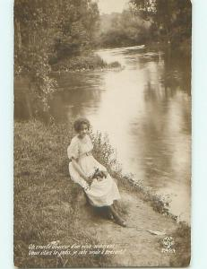 Circa 1910 rppc PRETTY GIRL HOLDING FLOWER BOUQUET BY THE RIVER r6676