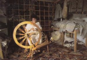 LE KAMOURASKA , Quebec , Canada , 1950-60s ;  Woman on spinning Wheel