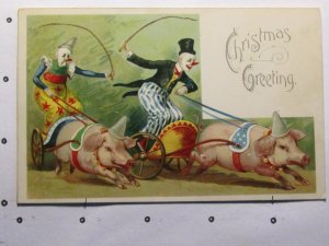 Christmas Greetings circa 1920's- colourful race with clowns and pigs