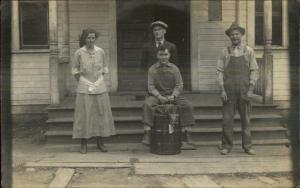 3 Young Men 7 a Woman - Sitting on Old Barrel Porch Steps Real Photo Postcard