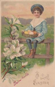 A Happy EASTER, Boy sitting on a fence holding basket of colored eggs, 00-10s
