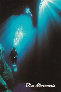 Guam Scuba Diver With Underwater Rays