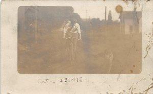 H83/ Ravenna Ohio RPPC Postcard c1910 Bicycle Rider Man  139