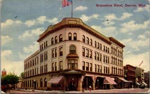 Detroit MI Brunswick Hotel American flag street view corner pedestrians stores