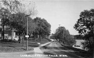 Fergus Falls Minnesota~Street Scene by Lake Alice~House~Man in Boat~c1910 RPPC