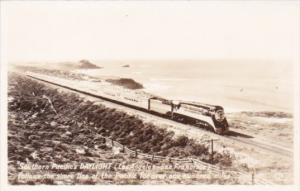 Trains Southern Pacific's Daylight Following The Shore Of The Pacific Ocean R...