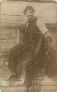 Old snapshot photo postcard pipe smocker girl with harmonica music instrument