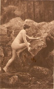 Nude lady climbing a rock Old vintage antique postcard