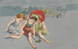 Young ladies sitting on beach watching a crab, 1901-07
