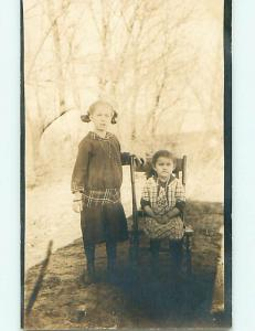 Pre-1918 rppc CUTE GIRL WITH BOW IN HAIR & SISTER ON CHAIR r5977