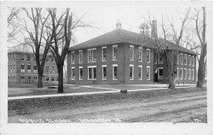 F99/ Marengo Iowa RPPC Postcard c1920s Public School Building