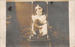 Real Photo Postcard~Little Girl in Baby Stroller Holds Steiff Teddy Bear~c1912