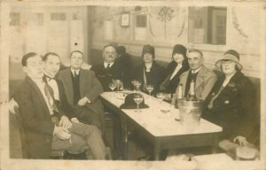 Social history photo postcard people party alcohol champagne restaurant interior