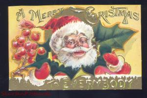 ANTIQUE VINTAGE CHRISTMAS POSTCARD SANTA CLAUS FACE IN HOLLY