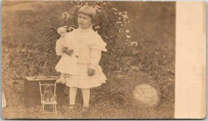 1910s RPPC Real Photo Postcard Girl Playing in Yard / Doll & Teddy Bear *Trimmed