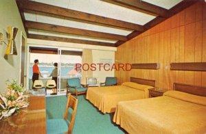 EDGEWOOD RESORT 1000 ISLANDS, ALEXANDRIA BAY, N. Y. couple enjoys balcony view