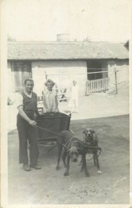 Social history Postcard man with young daughter cart dog breed