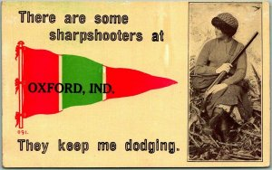 1912 OXFORD, Indiana Pennant Greetings Postcard WOMAN w/ GUN Rifle Hunting