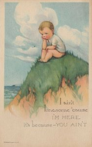 COMIC: 1900-10s; Lonely boy sitting on grassy hill by the ocean