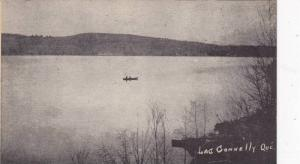 Row boat in the middle of Lac Connelly, Quebec, Canada, PU-1953