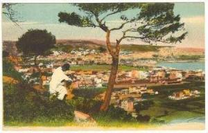 Man looks over town of Algiers, 00-10s