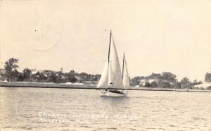 Muskegon-Lake Michigan~Sailboat 38-J197 Sails Down the Channel~RPPC c1909