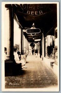 Postcard RPPC c1940s Panama Colon Sidewalk View of Shops M Dialdas & Sons Beer