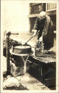 Chinese Man at Water Pump - Monk? c1910 Real Photo Postcard myn