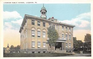 Ligonier Pennsylvania~Ligonier Public School~Church in Background~1920s Postcard