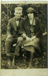 1910s 20s RPPC Rural Farm Man And Woman Seated On Log Postcard Americana