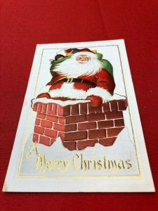 embossed postcard SANTA on chimney, China Doll In Toy Sack A Merry Christmas